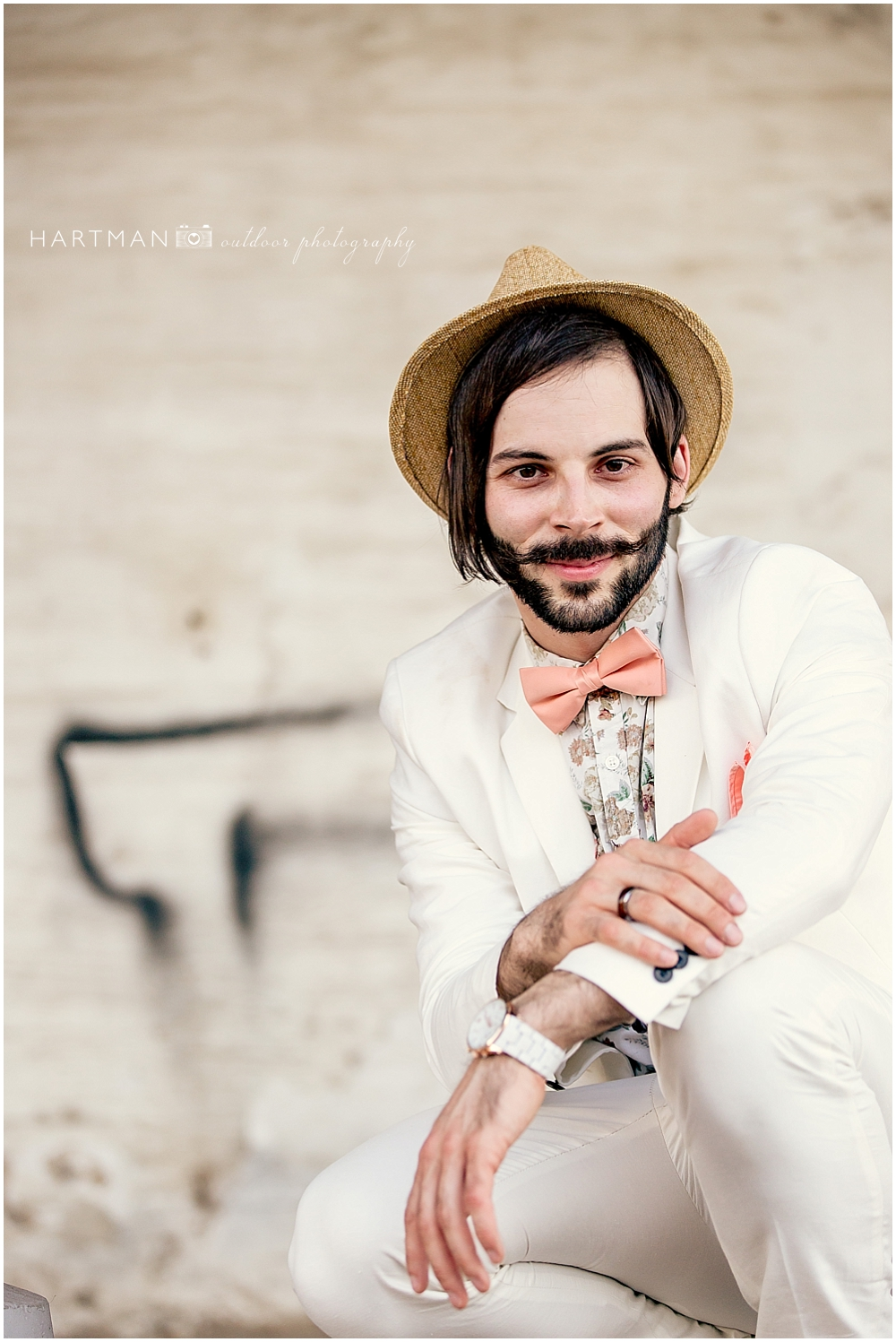 Groom with Hat and Pink Bowtie