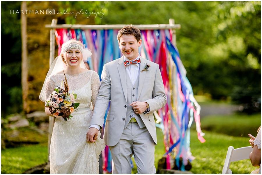 DIY wedding ceremony arbor backdrop photographer